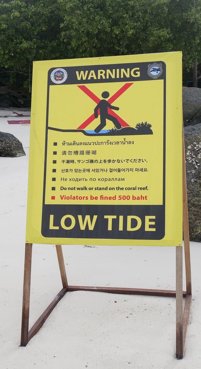 Despite this sign we noticed people walking on the coral reef