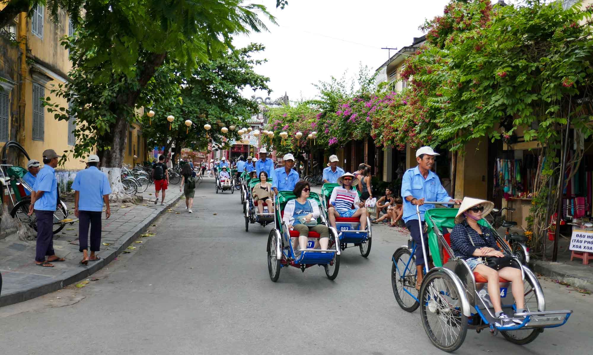 Tourist group on rickshaws in Old Town