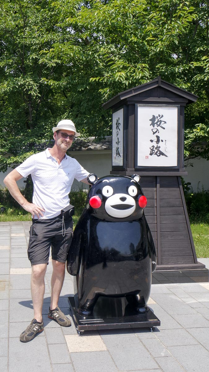 B and Kumamon, the mascot of Kumamoto