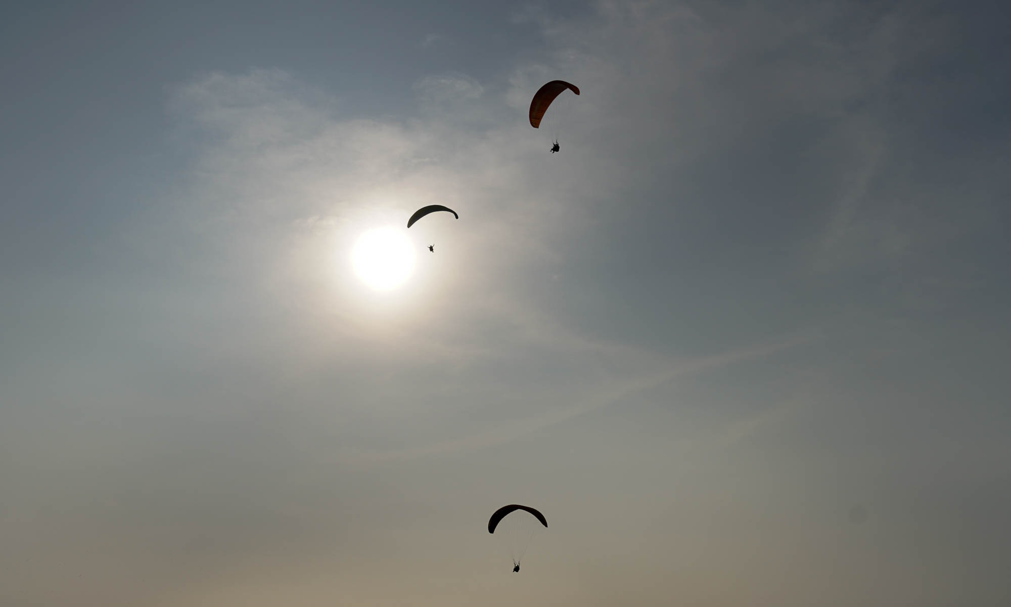 Paragliders above Lima's coast